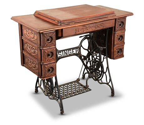 Antique Red Eye Treadle Sewing Machine with Cabinet