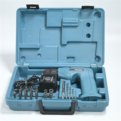 Makita Drill with Bits, Case and Charger